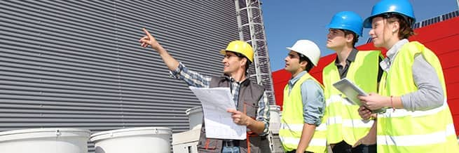 workers using a building information model to map out a construction job