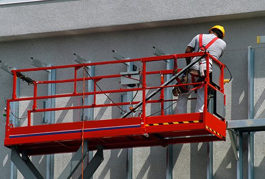 an operator operating a piece of powered mobile equipment