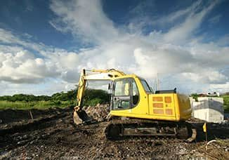 An excavator in a field
